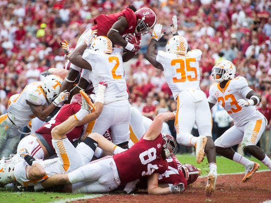 Alabama running back Bo Scarbrough (9) leaps into the