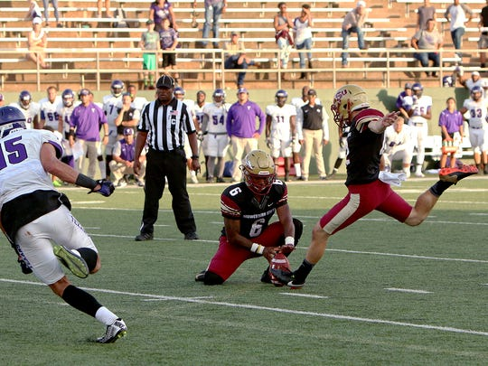 Midwestern State kicker Jaron Imbriani kicks the game-winning