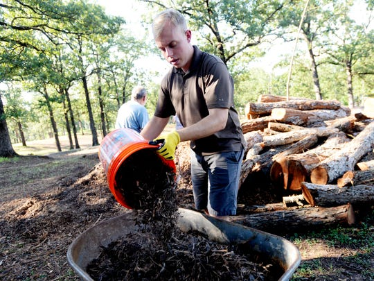 Tim Wright, founder of Re-Form Shreveport, works with others in Highland Park to help with drainage.