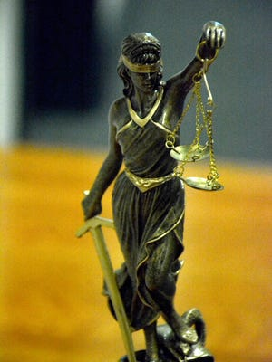 A statue of Justice sits atop the winning team's trophy. The Collier County Bar Foundation hosted their annual Mock Trial competition February 3 and 4, with high school students trying a case in an actual courtroom, and the winner moving on to the regional level.