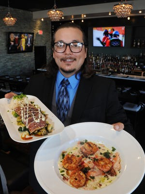 Noah Skultety, co-cowner of Twenty88 in Camarillo, displays the sesame crusted ahi and butternut squash ravioli with shrimp.