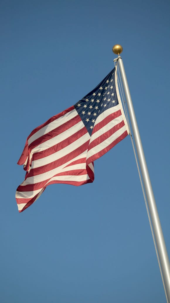 American flag billowing in the breeze. With illustration.
