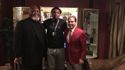 Tyler Friday (middle) with Alabama head coach Nick