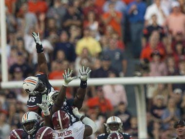Alabama kicker Adam Griffith makes one of his five field goals against Auburn on Saturday.