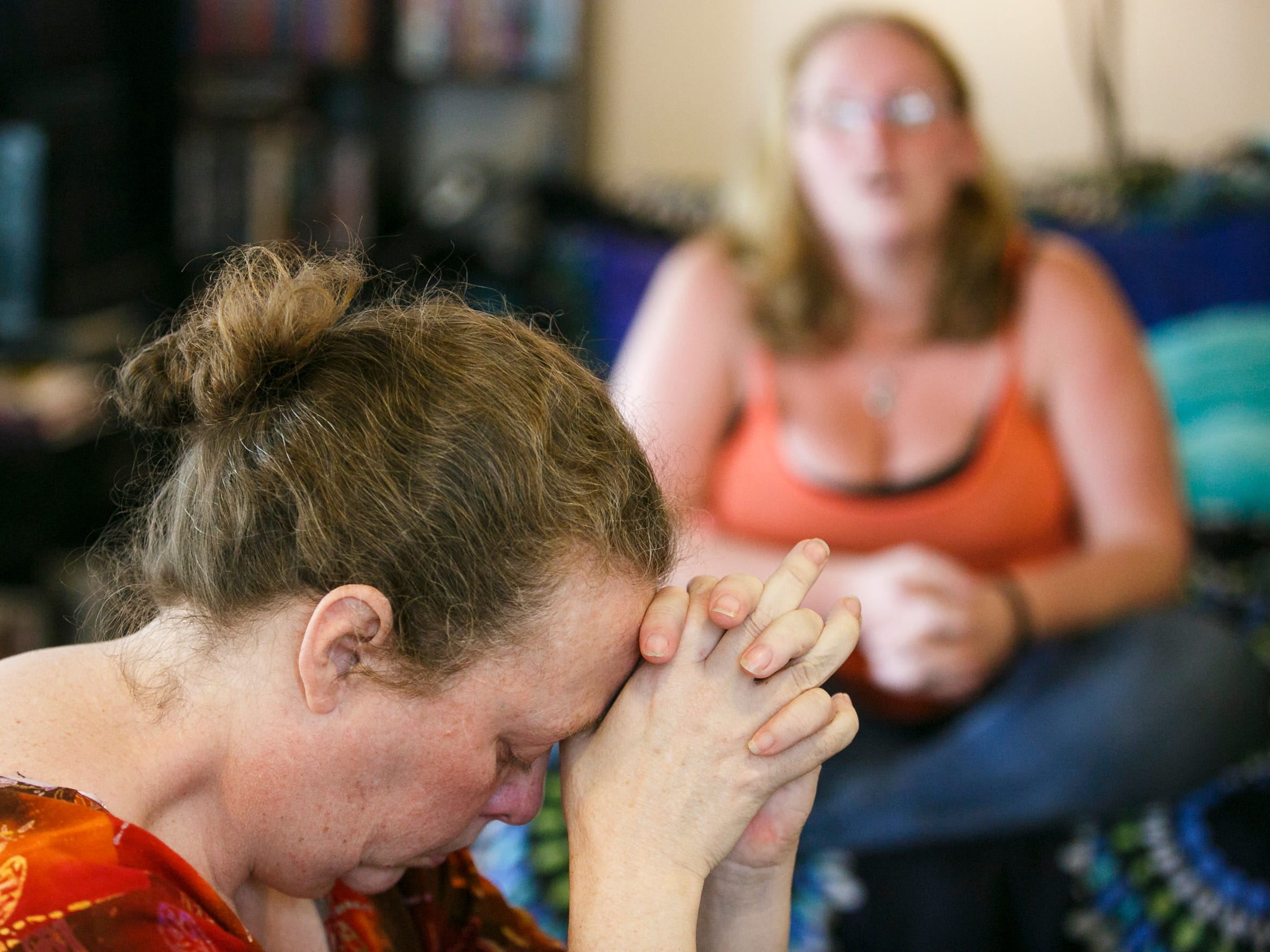"""Penny Woods cries as her daughter Mia Storm recounts her childhood spent in foster care. Woods gave up her children to the state while experiencing mental health problems. """"Allowing my children to go into state care was the worst decision I ever made,"""" she said."""