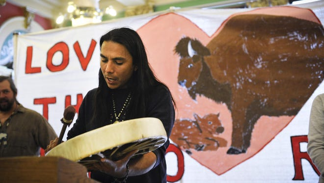 """Goodshield Aguilar plays the """"White Buffalo"""" song Thursday during a rally by the Buffalo Field Campaign in the rotunda of the Capitol in Helena."""
