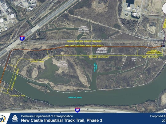 A map shows the location of a bridge across the Christina River (left) and boardwalk across the marshland, which will open in 2018.