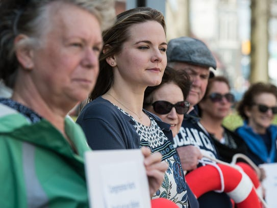 Rallygoers stand side by side during an effort to ask U.S. Rep. Andy Harris to maintain coverage for cancer patients under future replacements of the Patient Protection and Affordable Care Act, downtown on Tuesday, March 7, 2017.  Staff photo by Ralph Musthaler