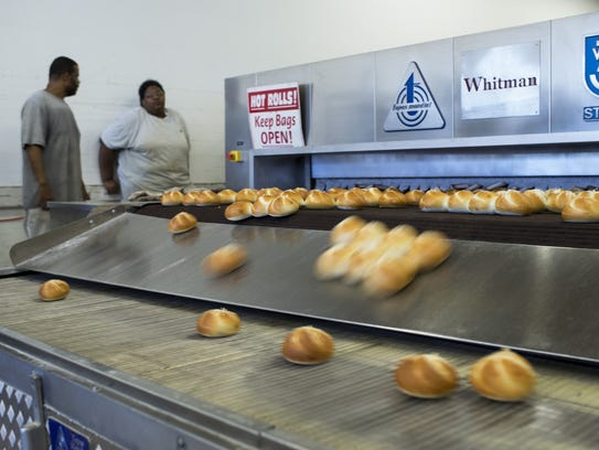 Freshly baked rolls come out of an oven Wednesday,