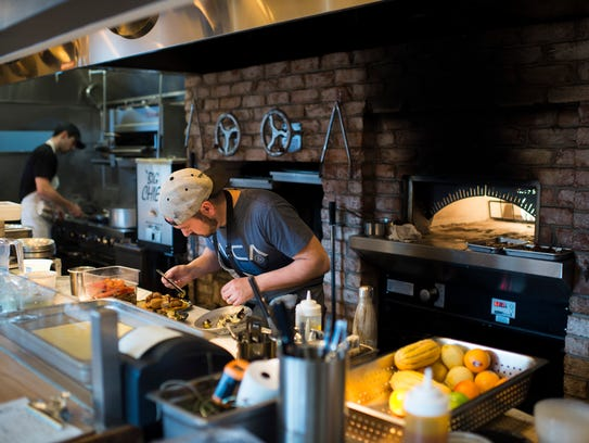 Chef and owner Dominic Piperno works on a dish inside Hearthside in Collingswood.
