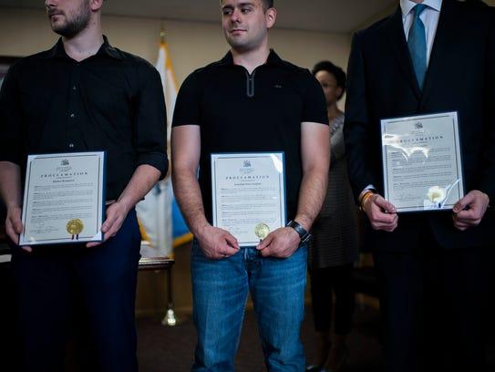 Rutgers graduates Matteo Resanovic, from left, Jonathan