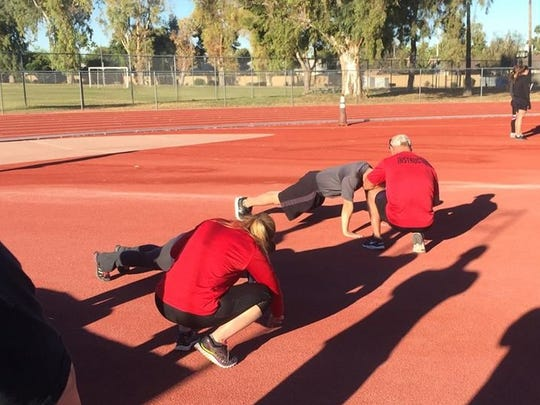 Glendale officers complete push-ups to pass the Cooper