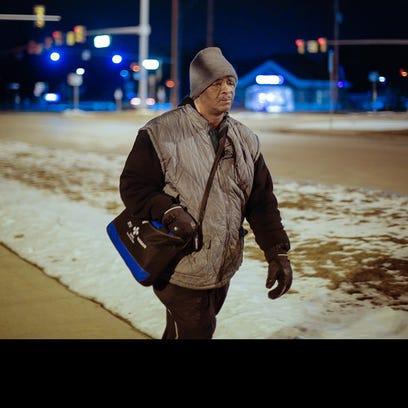 James Robertson, 56, of Detroit, makes his way along