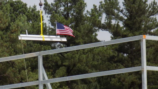 A beam signed by officials from Mercy Fort Smith, Arkansas Colleges of Health Education (ACHE), McCarthy Building Companies and Kindred Healthcare is lowered into place at Mercy Rehabilitation Hospital Fort Smith on Wednesday, July 1, 2020 during a Tops Out ceremony.