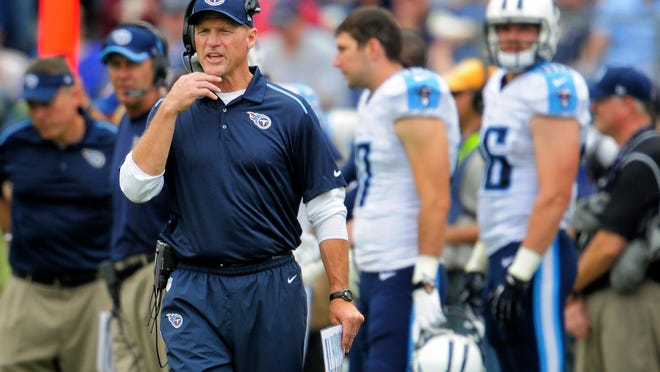 Titans head coach Ken Whisenhunt yells instruction to his players during the fourth quarter in their game against the Jaguars at LP Field.