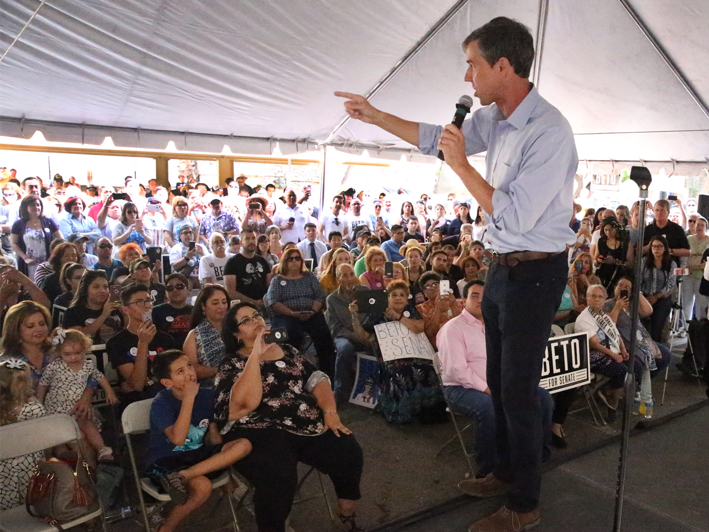U.S Rep. Beto O'Rourke talks from a stage to a large gathering of local supporters during a 'Menudo & Mariachi' campaign stop in his hometown of El Paso in a parking lot at 415 E. Yandell Drive near downtown El Paso Sunday. About 1,000 people showed up to have menudo, listen to a mariachi group and hear O'Rourke deliver a rousing talk in which he announced the start of a 34-day road trip to visit 50 cities and more than 100 town hall events.  He said El Paso should be the example for the rest of the country. 'This is a time to celebrate the fact that people chose to come here to this community to start their lives in the United States of America in El Paso Texas USA.' 800 people sent in reservations via social media in advance, campaign workers said. O'Rourke said his campaign has raised $10.4 million from individual contributions without taking any money from political action committees or special interest groups.