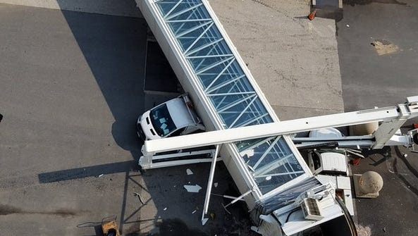 An elevated gangway at the Port of Baltimore crashed