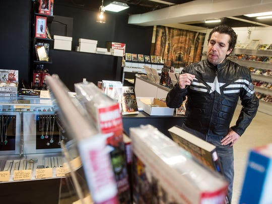 Matthew Madrigale, owner of Kirby Comics on York Street, stands beside the counter of his store, Tuesday, Jan. 9, 2018. Kirby Comics, on York Street, is Hanover's newest comic book store. It opened in December, 2017.