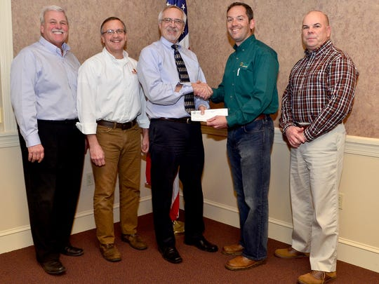 Members of the York Builders Association present check to Bill Rhinesmith of ForSight Vision.  From right:  Barry Strine of Strine's Heating & Air Conditioning, Paul Deller of Red Oak Remodeling; Bill Rhinesmith, President of ForSight Vision, Ted Ventre of Hively Landscapes and Robert Myers, III of John H Myers & Son.  Missing from the picture are:  Leo Deller, Phil Trump of Trump Lawn & Landscaping, students at York County School of Technology, and George Deller of Jensco Construction.