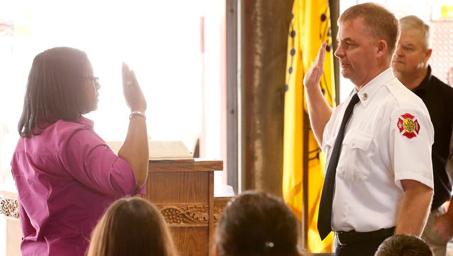 Joseph Martino is sworn in Friday by city clerk Angela Williams as the new City of Elmira fire chief. He replaces longtime chief Patrick Bermingham,