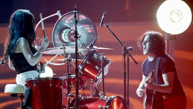 """Jack White, right, and Meg White, of the White Stripes, perform """"Seven Nation Army"""" during the 46th Annual Grammy Awards in February 2004 in Los Angeles."""
