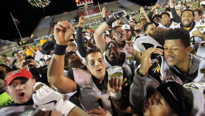 Appalachian State celebrates its victory in the Dollar General Bowl.