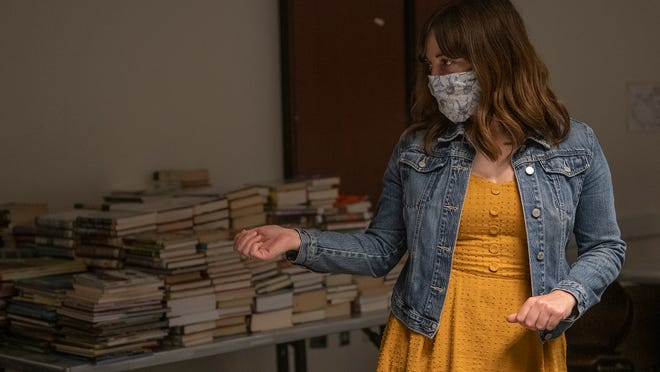Katie Hughes, branch manager of the Nordonia Hills Branch Public Library, stands in the book quarantine room where returned books spend three days before being put back into circulation.