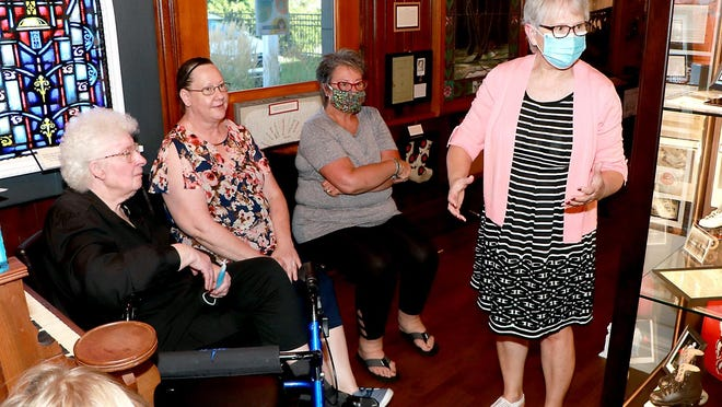 Dianne Gorsuch visits with the families of Gladys Johnston, Janelle Dunlap and Natalie Setterblad. Sturgis Historical Museum -- At the Depot has dedicated exhibit space to Johnston's Skate-O-Rama.