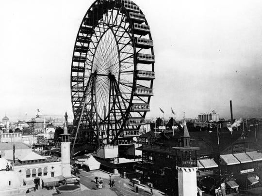 This May 1893 file photo shows the grounds of the 1893 World's Columbian Exposition in Chicago. The first ferris wheel, which carried 1,400 persons 250 feet into the air, was one of the biggest attractions.