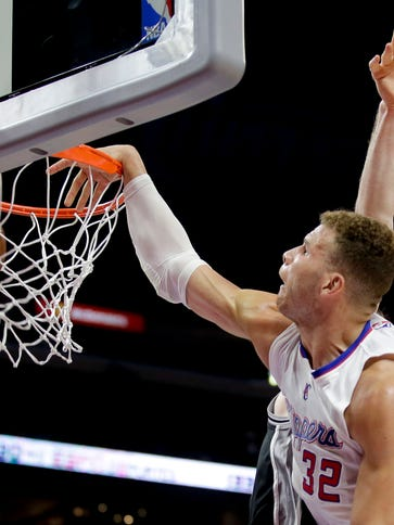 Los Angeles Clippers forward Blake Griffin ducks against