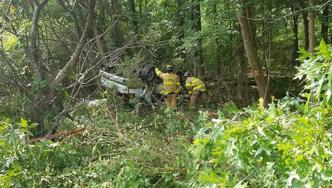 Firefighters on scene of a fatal crash on I-684 in Purchase Thursday. Police said one person was killed in the single-car accident.