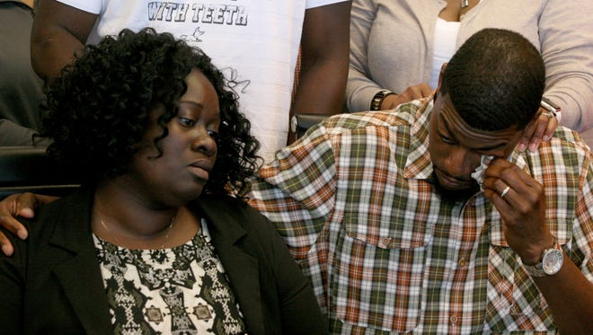 Odell Edwards wipes away tears as he sits with his wife, Charmaine, listening to their attorney Lee Merritt talk about the death of their son, Jordan Edwards, in a police shooting in Balch Springs, Texas.