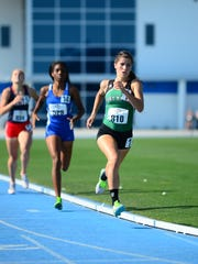 Fort Myers junior Krissy Gear takes the lead in the 1,600-meter run on Saturday at the FHSAA Championships at IMG Academy in Bradenton. She won the race for the second straight season.