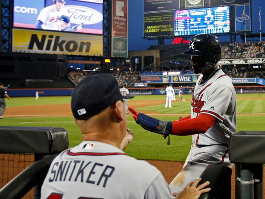 Atlanta Braves left fielder Ronald Acuna Jr. (13) celebrates scoring a run with Braves manager Brian Snitker (43) against the New York Mets during the fifth inning at Citi Field.