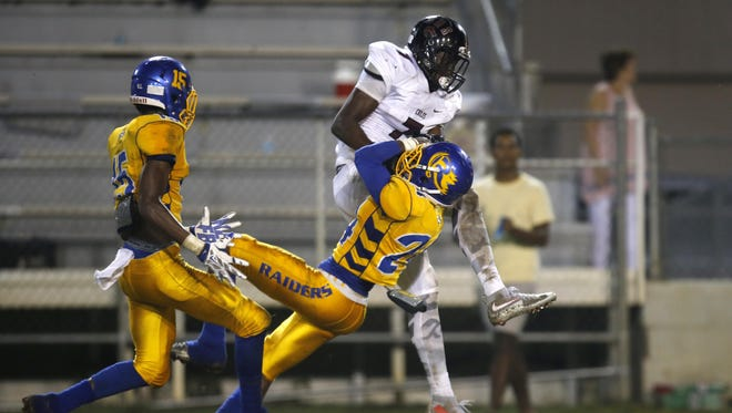 Chiles receiver John Mitchell and Rickards defender Tavyn Jackson fight for a reception that Mitchell came down with during Thursday's regular-season finale at Cox Stadium. Mitchell caught three passes for 104 yards in a loss to the Raiders.