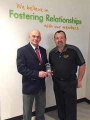 Kevin Nemyer (left) is presented with the first Thrive Community Leader Award.