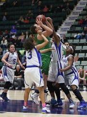 Seton Catholic's Julia Hauer drives to the basket Sunday