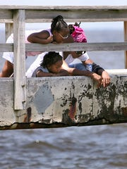 Sydney Proctor, 7, along with her brother, Devon, 3,