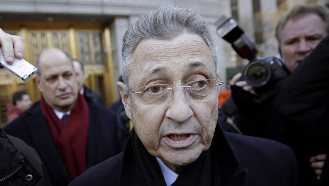 New York State Assembly Speaker Sheldon Silver leaves a federal courthouse in New York Thursday. Silver, 70, was arrested on public corruption charges.