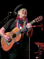 "Willie Nelson performs with his guitar ""Trigger"" during Fire Relief, The Concert For Central Texas at the Frank Erwin Center in Austin, Texas Oct. 17, 2011."