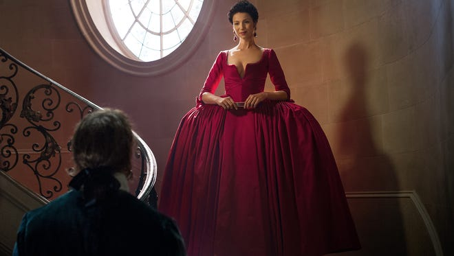 Take it from Caitriona: Walking in a gown like that is far from easy.