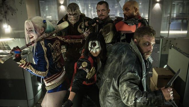 "Harley Quinn (Margot Robbie), Killer Croc (Adewale Akinnuoye-Agbaje), Katana (Karen Fukuhara), Rick Flagg (Joel Kinnaman), Deadshot (Will Smith) and Captain Boomerang (Jai Courtney) are ready for action in ""Suicide Squad."""