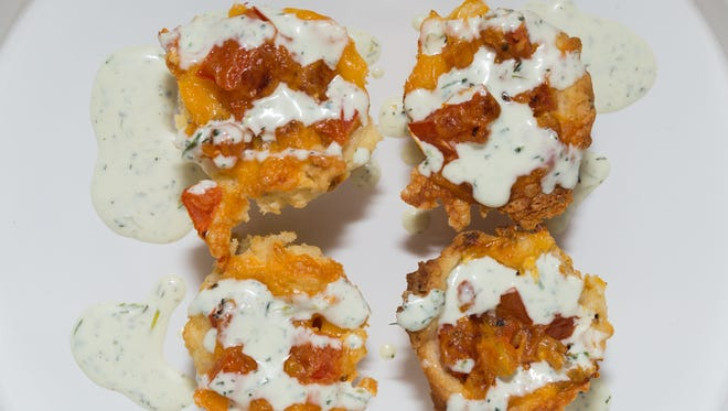 Tomato pies with ranch dressing drizzle