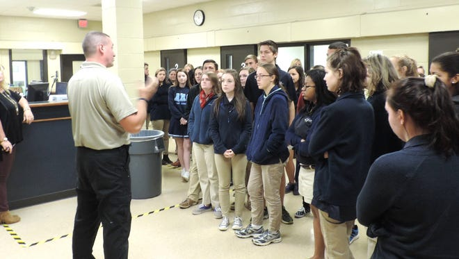 Sgt. Jeremy Haas, instructor at the North Louisiana Criminal Justice Academy, gives the BYL students a tour of the Bossier Maximum Security Facility.