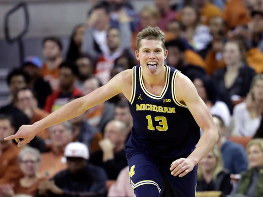 Michigan forward Moritz Wagner (13) celebrates after he scored against Texas during the second half of U-M's 59-52 win on Tuesday, Dec. 12, 2017, in Austin, Texas.