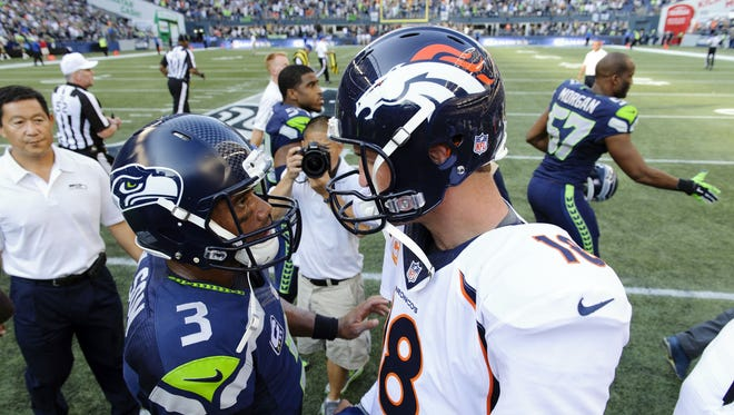 The Lions have the honor of facing these two quarterbacks back-to-back in Weeks 3 and 4: Broncos quarterback Peyton Manning, right, and Seahawks quarterback Russell Wilson.
