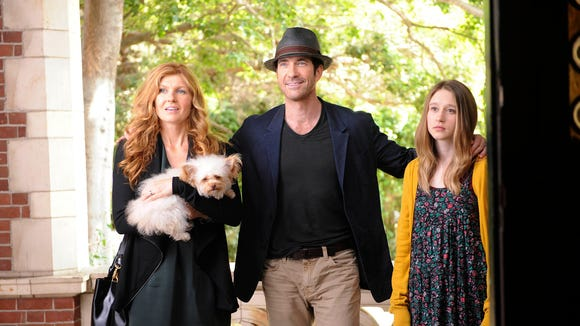 "Connie Britton, Dylan McDermott and Taissa Farmiga in ""American Horror Story: Murder House."""