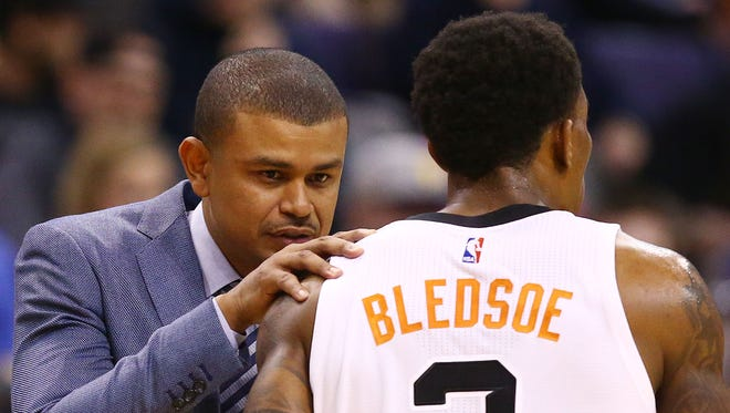 Phoenix Suns head coach Earl Watson talks to Eric Bledsoe against the Minnesota Timberwolves in the first half on Jan. 24, 2017 in Phoenix, Ariz.
