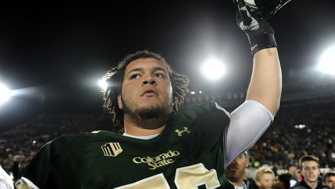 CSU lineman Nick Callender celebrates with his teammates following a 2014 win over Utah State at Hughes Stadium. Callender signed a free-agent contract Thursday with the Indianapolis Colts.