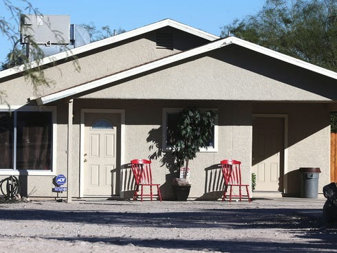 This Tuesday photo shows the home where three girls were allegedly imprisoned by their mother and stepfather in Tucson.
